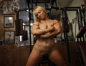 Female bodybuilder Genie is at it again, posing and flexing her bulging muscles