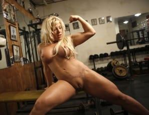 masturbates her big clit and poses
