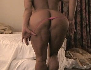playing with her pecs and showing off her big calves
