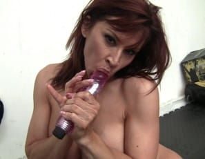 she pushes a buzzing vibrator all the way into her wet pussy and cums