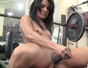penetrates herself with it, lifting up her legs and glutes so you can see her pretty pussy