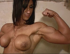 her naked pecs and her muscular biceps, legs and abs
