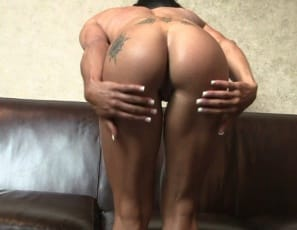strokes her big biceps and tattooed abs, then masturbates her swollen clit