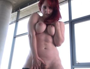 She's penetrating herself with her finger, then turning around to play with her ass