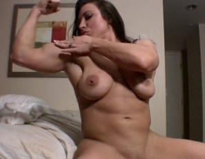 Female bodybuilder BrandiMae is masturbating in the bedroom