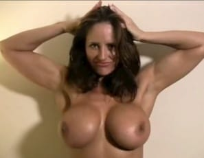 she's nude and showing off her powerful pecs