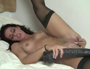 playing with a gigantic toy she calls a big black dick