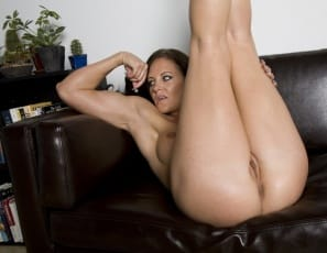 poses nude in high-heeled shoes, showing off her sexy pecs
