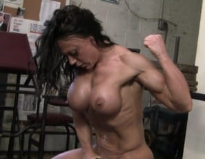 poses, and masturbates her big clit, while you enjoy looking at her muscular, vascular pecs